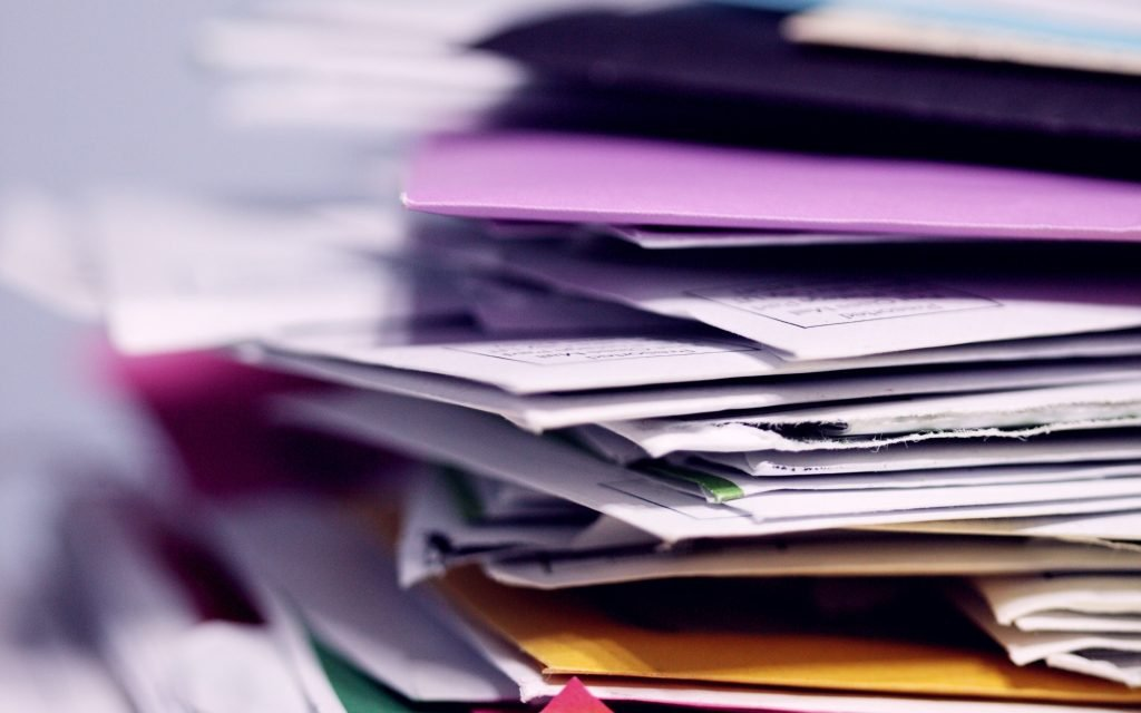 A stack of accountants' paperwork and files.